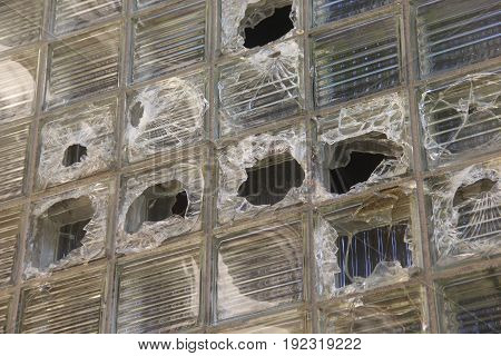 Shattered and broken glass boxes on an abandoned building