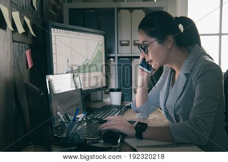 Seriously Young Woman Sitting At Her Desk