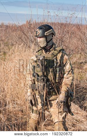 airsoft soldier with a rifle and full amunition