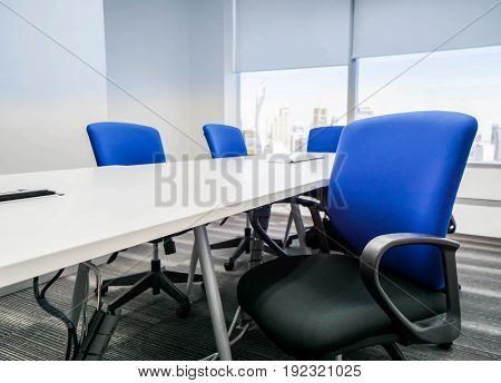 blue office chair with backrest in meeting room for seating