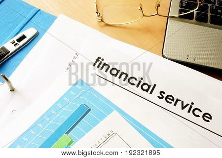 Papers with title financial service. Business concept.