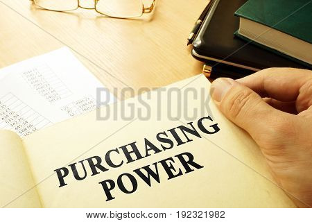Book with page about purchasing power. Business concept.