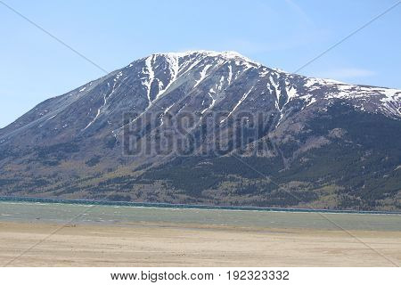 A mountain with glaciers on summer day