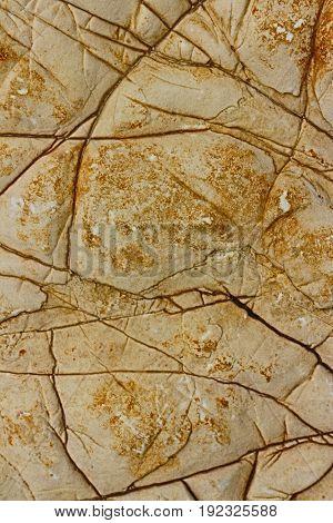 Cracked brown rock background. Full frame close up.
