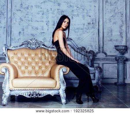 beauty young brunette woman in luxury home interior, fairy bedroom in grey colors, rich lifestyle concept close up