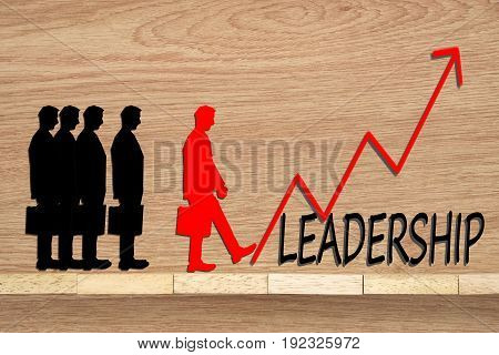Leadership and team abstract business concept Wooden blocks and businessman with red growth arrow.