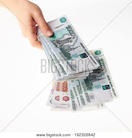Female Hand Holding A Large Amount Of Russian Money Rouble.