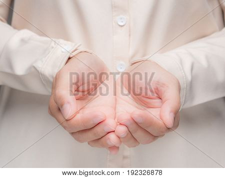 empty palm hands giving or begging gesture
