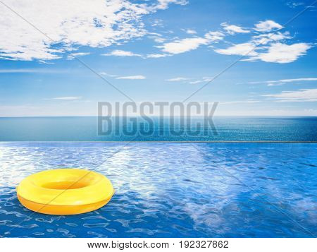 3d rendering swim ring on infinity pool with blue sea and blue sky