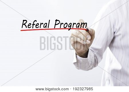 Businessman hand writing Referral Program with marker Business and Internet concept