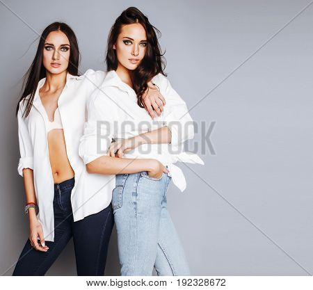 two sisters twins girl posing, making photo selfie, dressed same white shirt, diverse hairstyle friends, lifestyle people concept close up