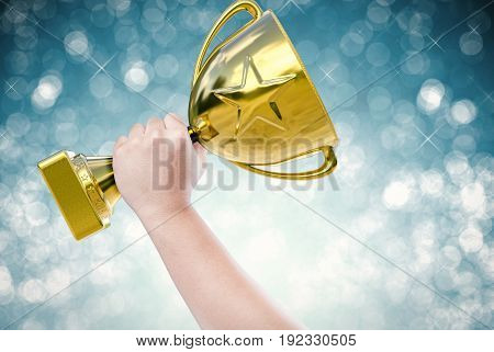 hand holding golden trophy with blue background