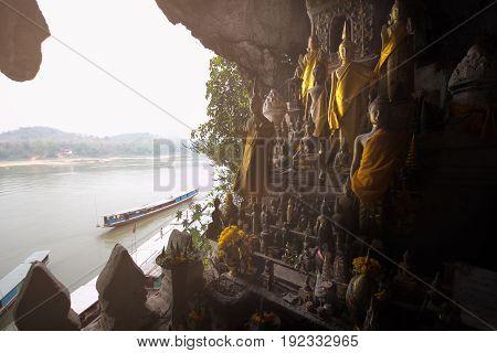Buddha statues of Pak Ou caves in Luang Prabang, Laos