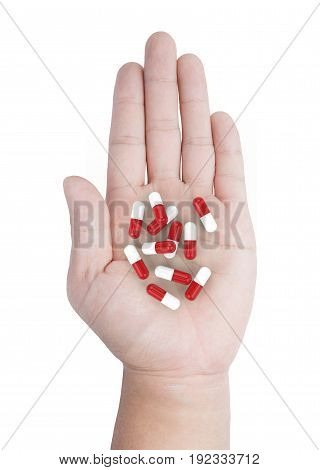 hand holding heap of capsule pill on white background