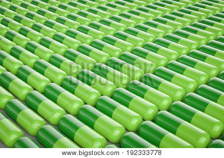 3d rendeirng green capsule pills in a row