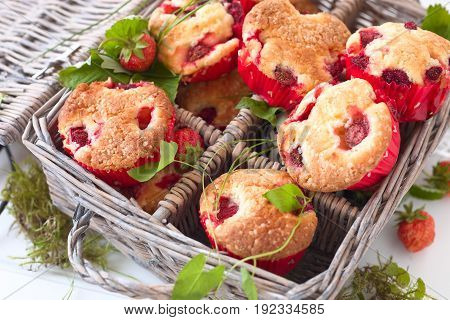 Fresh homemade delicious berry muffins in a picknick basket