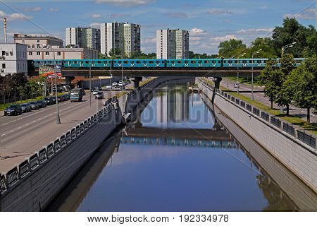 Moscow Russia - June 18 2015: Metro (underground) train goes by Preobrazhenskiy bridge on Yauza river in Moscow