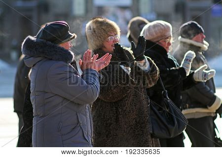 Volgograd Russia - February 02 2014: People clap their hands on a city holiday in Volgograd