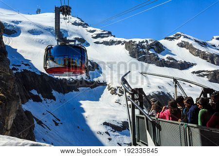 Mt. Titlis Switzerland - May 28 2017: a gondola of the Rotair cable car view from the station on the top of the mountain. Rotair gondolas make a 360 degrees turn during.