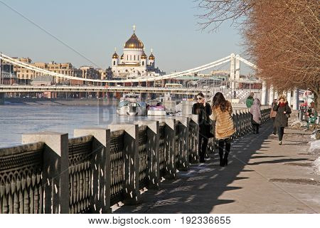 Moscow Russia - February 17 2015: People walking along Pushkin embankment in Gorky Park