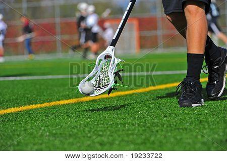 Lacrosse ball in a head