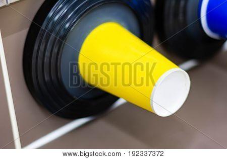 plastic glass in storage cylinder under cooler machine in convenience store