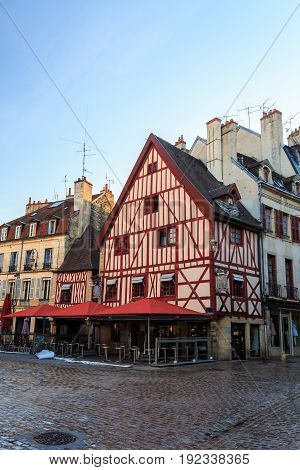 Medieval old timbered buildings in the historic city square of Dijon Burgundy France