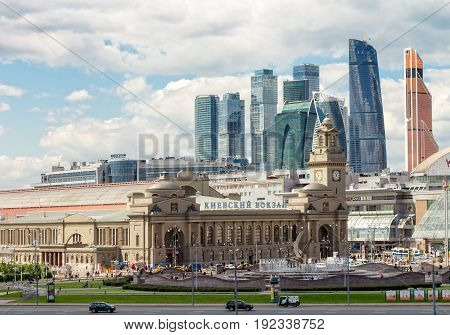 MOSCOW RUSSIA - JUNE 6 2017: Kiev railway station Europe Square with skyscrapers international business center