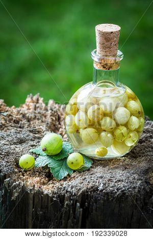 Sweet Liqueur Made Of Alcohol And Gooseberries In Summer