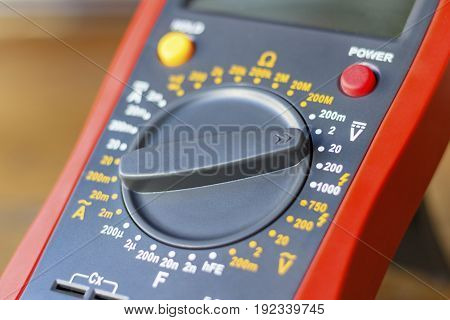 Digital Multimeter On A Wooden Table In The Workshop Closeup