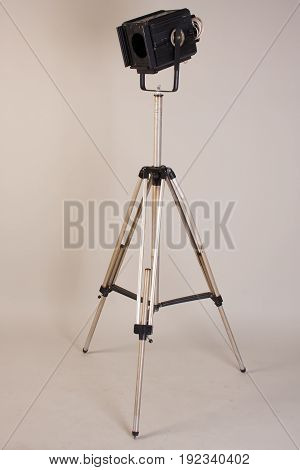 Old Theater Lamp On A Tripod On A Gray Background