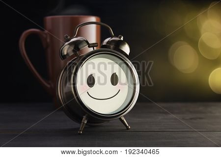 Alarm clock and brown mug with a happy smile, Good morning or Have a happy day message concept