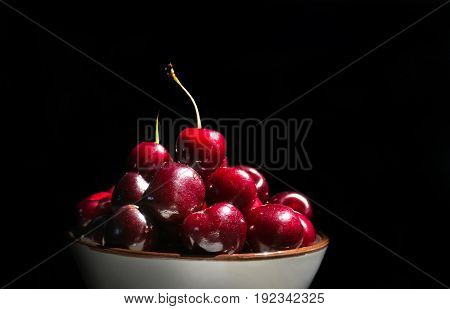 Cherries On A Black Background