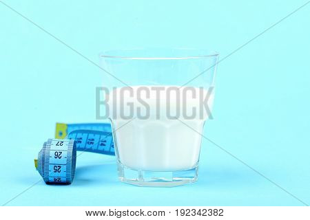 Roll Of Tape For Measuring Next To Glass Of Milk