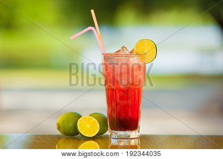 Non-alcoholic drink and fruit on a table with a blurred background.