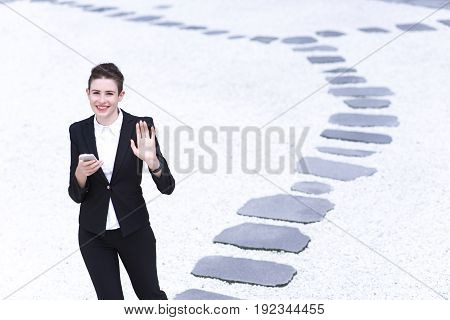 Modern Business Woman Playing Smartphone