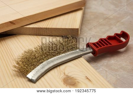 Metal brush for grinding wood products before polishing