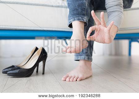 woman athlete foot close up with health concept