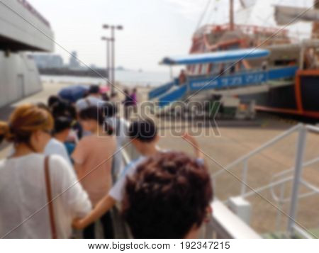 Abstract blur of Passengers wait to board the River Boat