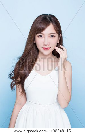 beauty woman look you on the blue background