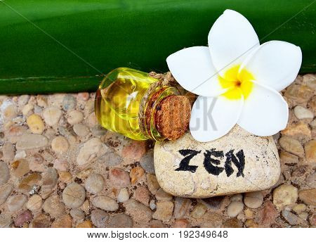 Spa decoration with massage oil,frangipani flower and zen stone.Spa concept.Selective focus.
