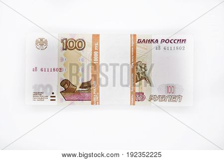 one bundle of 100 pieces banknotes 100 one hundred rubles banknote of the Bank of Russia on white background Russian rubles