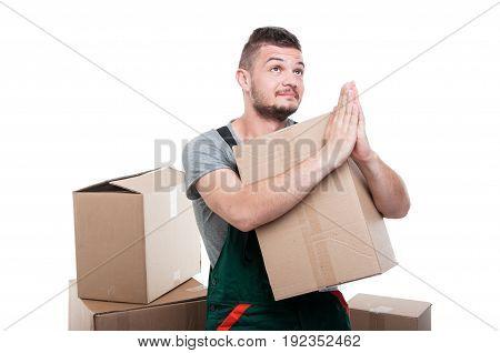 Mover Guy Holding Cardboard Box Gesturing Prayer