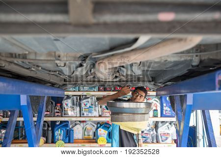 Car Mechanic Drain The Old Lubricant Engine Oil
