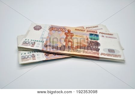 a few banknotes 5000 rubles of Bank of Russia on white background Russian rubles