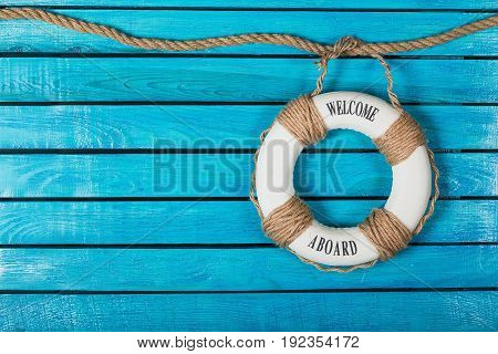Blue background life wood lifebuoy buoy red