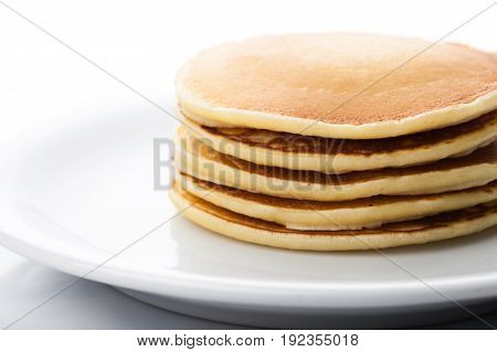 Tasty butter pancakes close up yellow background close-up