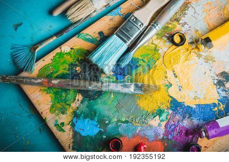 Oil paint palette paints close up top view color palette