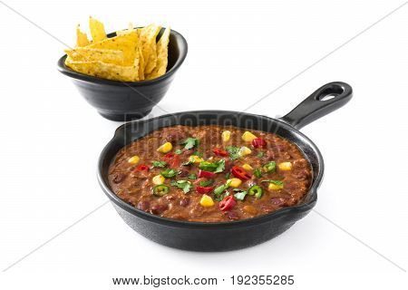 Traditional mexican tex mex chili con carne in a frying pan isolated