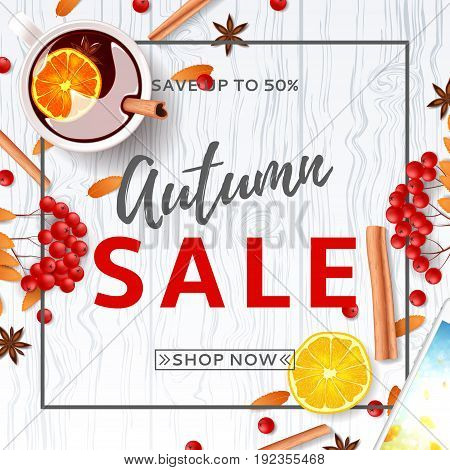 Beautiful background for autumn sale. Top view on composition with cup of mulled wine, rowan, cinnamon sticks on wooden texture. Vector illustration.